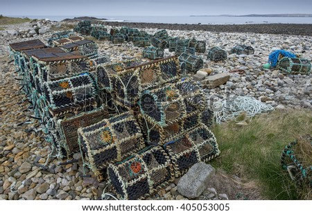Lobster cages on the beach full of pebbles on the west coast of Ireland.