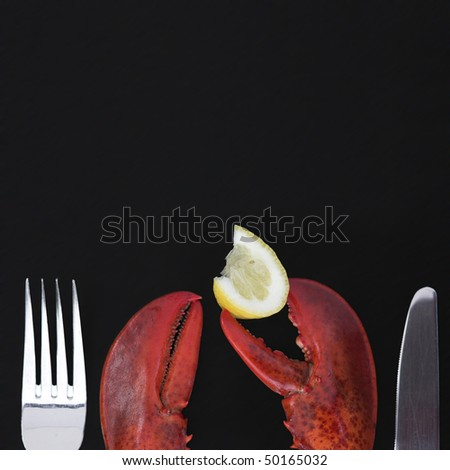 Lobster claws, lemon & a knife & fork - shallow dof (background quite grainy)