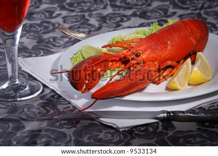 Lobster Dinner served on plate with lemon - stock photo