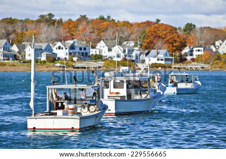 Lobster fishing vessels at sunset in Maine, New England - stock photo