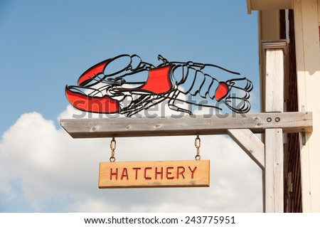 Lobster hatchery sign, Atlantic coast of Canada - stock photo