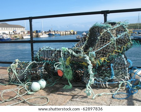Lobster Pots in St Marys harbour, Isles of Scilly UK - stock photo