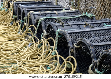 Lobster Pots lined up at Mudeford Harbour, Dorset - stock photo