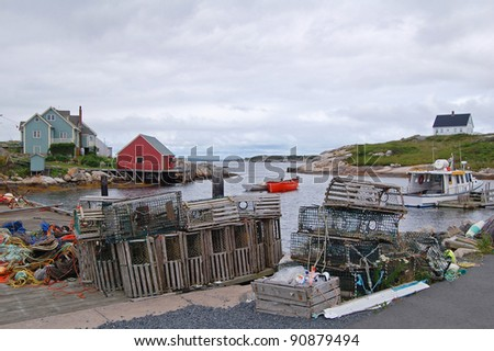 lobster pots on quayside in peggys cove, nova scotia, canada - stock photo