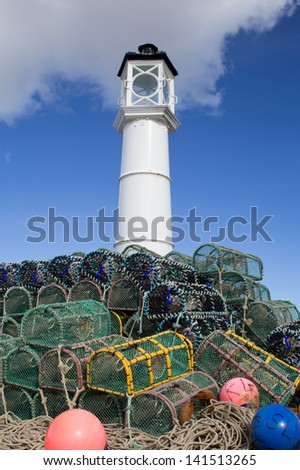 Lobster pots stacked on top of each other at Kirkwall harbour, Orkney - stock photo