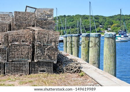 Lobster Traps and Pilings at the Dock - stock photo