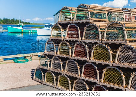 Lobster traps piled at the wharf in rural Prince Edward Island, Canada. - stock photo