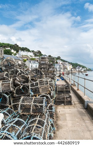 Lobster traps stacked on Aberdovey harbour in Wales - stock photo