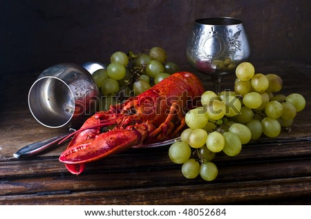 lobster with grapes and silver goblets