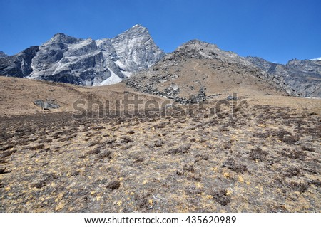 Lobuche East and Lobuche West summits and other. Himalayas mountain panorama view from way to Everest Base Camp - Sagarmatha National Park, Nepal. - stock photo