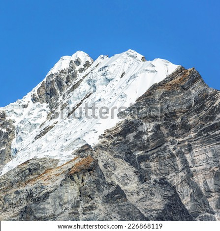 Lobuche peak with a group of climbers during the summit on background, view from Periche village - stock photo