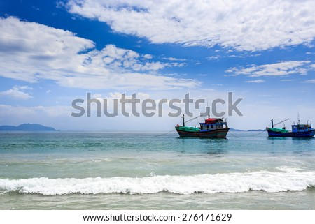 Local Boats At Morning in Doc Let beach, Nha Trang central Vietnam