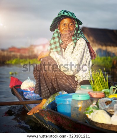 Local Cambodian Seller Floating Market Siem Reap Concept - stock photo