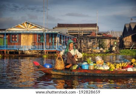 Local Cambodian seller in floating market. - stock photo