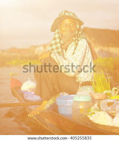 Local Cambodian Seller In Floating Market Concept - stock photo