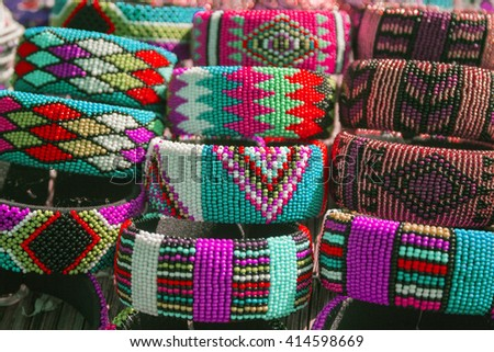 Local craft market in South Africa. Unique handmade colorful beads  bracelets, bangles. Craftsmanship. African fashion. Traditional ornament, accessories. - stock photo