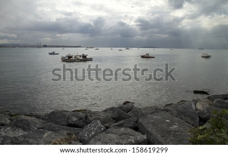 Local Fishing Boats Swaying on the Waves in Bosphorus - stock photo