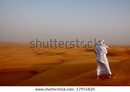 Local man looking out into the desert (Dubai) - stock photo