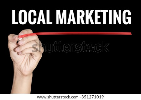 Local Marketing word writing by men hand holding highlighter pen with line on dark background - stock photo