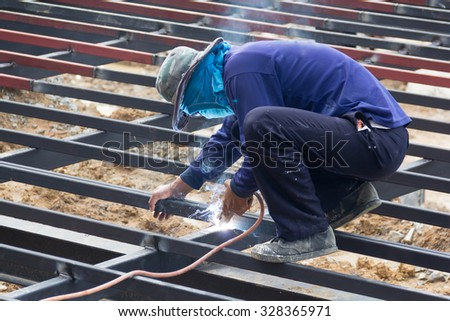 local metal worker is welding steel structure for new house terrace, Thailand