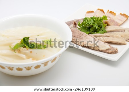 Local noodle Thai soup with boiled pork meat for delicious meal on white background - stock photo