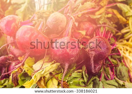 Local produce at the summer farmers market in the city. - stock photo