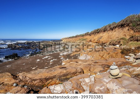 Local rock art, rock, and unusual geological formations at low tide, along the rugged Big Sur coastline, near Monterey, CA. on the California Central Coast. - stock photo