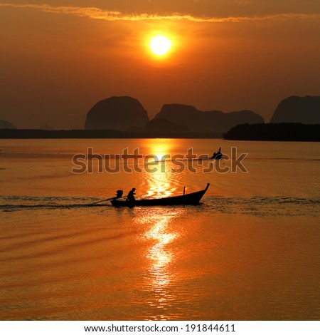 Local small fishing boat moving with sunrise in Phang Nga , Thailand - stock photo