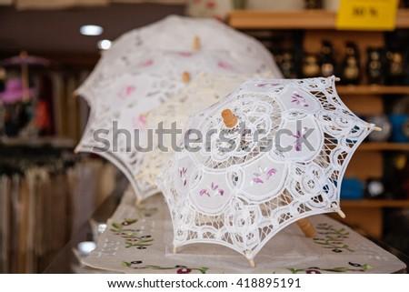 Local souvenir store - umbrellas in Lefkara, Cyprus - stock photo