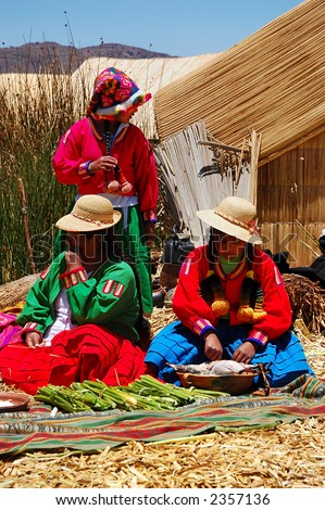 Local women on a floating Uros island knitting clothes and tapistries and trading