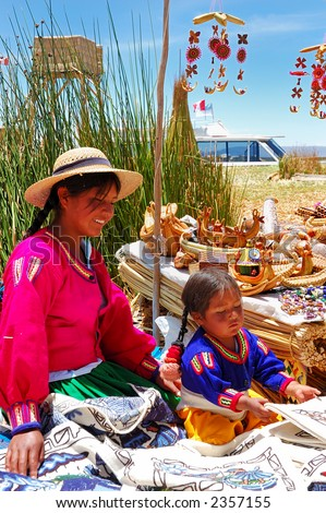 Local young girl on a floating Uros island selling handmade items