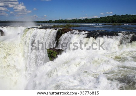 located between brazil and argentina, the iguazu waterfalls are one of the most important touristic destinations