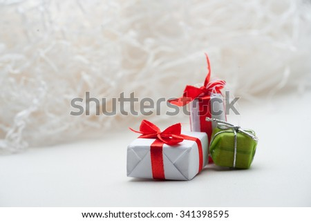 Located on a white background with snowflakes, gift box. Christmas gifts, sleighs, snowflakes,