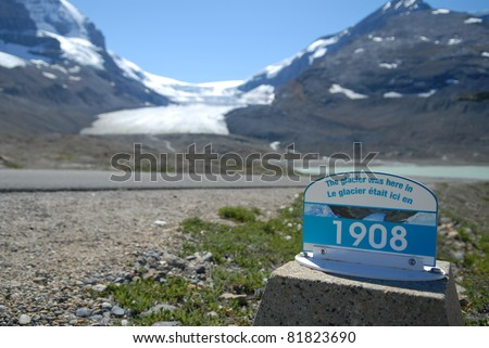 Location and date marker for glacier in Jasper National Park in Canada. Clear evidence of global warming. - stock photo