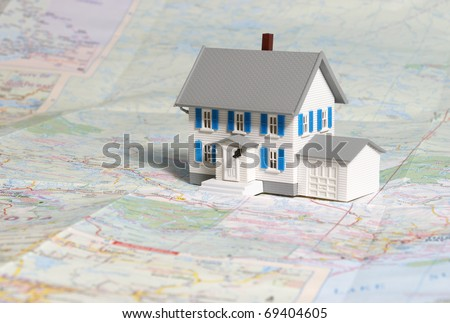 Location is always an issue when dealing with properties and this house on a map gives great meaning to that concept. - stock photo