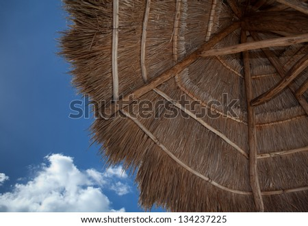 Location shot of a thatched umbrella
