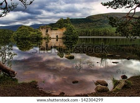 Loch an Eilein Castle - stock photo