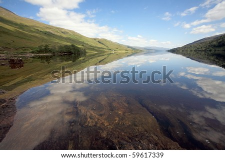 Loch Arkaig on a calm summers day. - stock photo