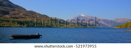 Loch Leven Lochaber Geopark Scotland uk view to Glen coe in Scottish Highlands with boat panorama