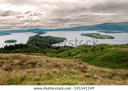 Loch Lomond is a freshwater Scottish loch, lying on the Highland Boundary Fault. It is the largest inland stretch of water in Great Britain by surface area.Loch Lomond is a popular leisure destination - stock photo