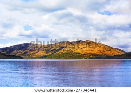 Loch Lomond, Scotland, from West Highland Way under cloudy sky  - stock photo