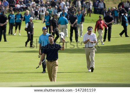LOCH LOMOND, SCOTLAND - JUL 12 2009; Loch Lomond Scotland; Martin Kaymer (GER) acknowledges the crowd as he approaches the 18th green on his way to win the PGA European Tour Barclays Scottish Open golf tournament.  - stock photo