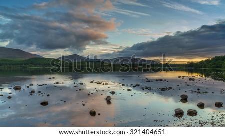 Loch Morlich at sunset - stock photo