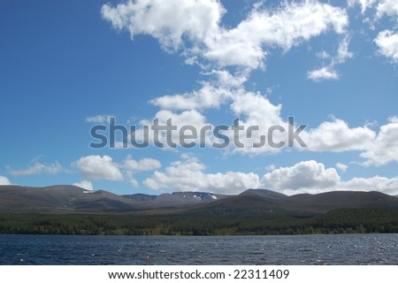 loch morlich with a backdrop of the cairngorms in scotland - stock photo