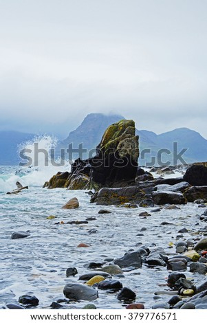 Loch Scavaig sitting out an incoming storm with low cloud and sea mist covering the distant Cuillin Hills in Summer, Elgol, The Isle of Skye, Scotland  - stock photo