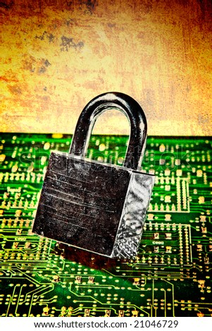 lock and circuit board, concept of online safety - stock photo