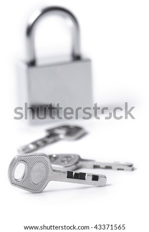 Lock and keys on the white background - stock photo