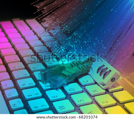 Lock and network cable with computer keyboard background - stock photo