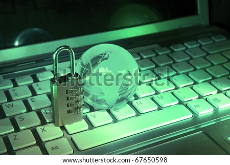 Lock and world map with computer keyboard background - stock photo