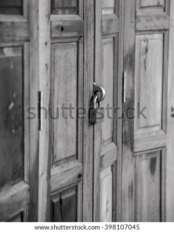Lock doors on monochrome  - stock photo